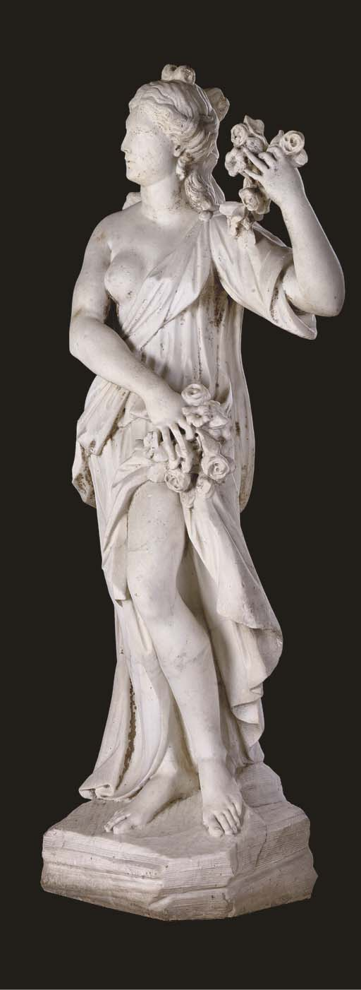 A SCULPTED WHITE MARBLE FIGURE