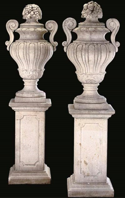 A PAIR OF LIMESTONE URNS AND P