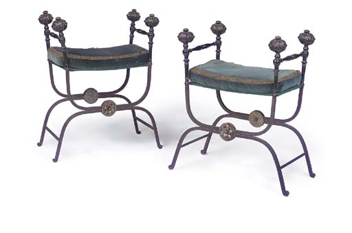 A PAIR OF WROUGHT IRON AND BRA
