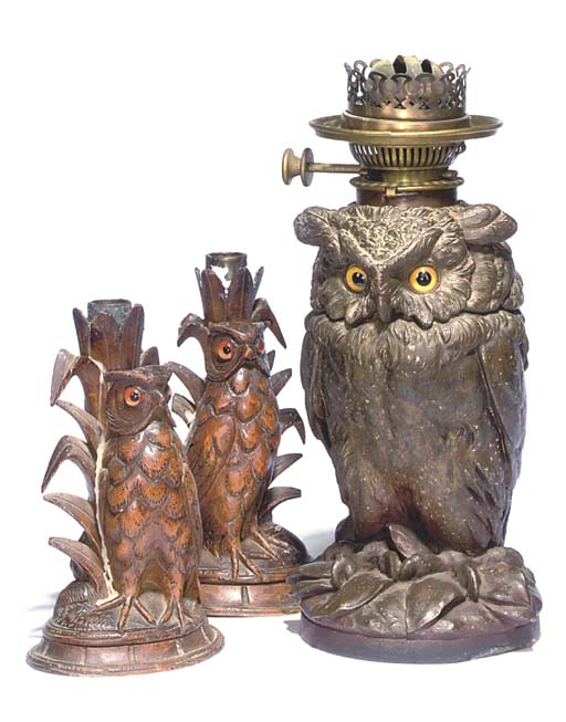 A BRONZE PATINATED SPELTER OWL