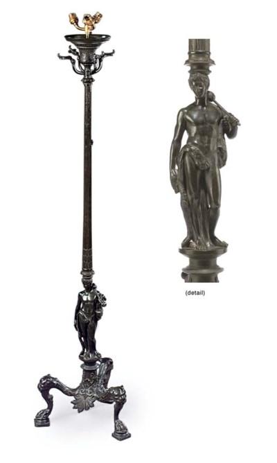 A BRONZE FLOOR STANDING LAMP