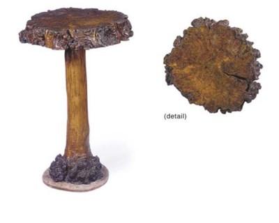 A RUSTIC PEDESTAL TABLE