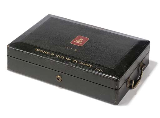 A GILT-TOOLED GREEN LEATHER MINISTERIAL BOX