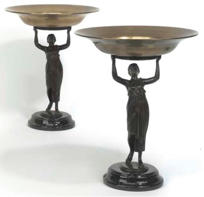 A PAIR OF BRONZE FIGURAL TAZZE