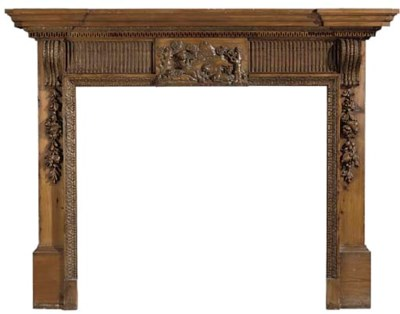 A CARVED PINE FIRE SURROUND