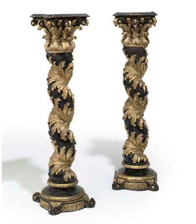A PAIR OF EBONISED AND GILT RE