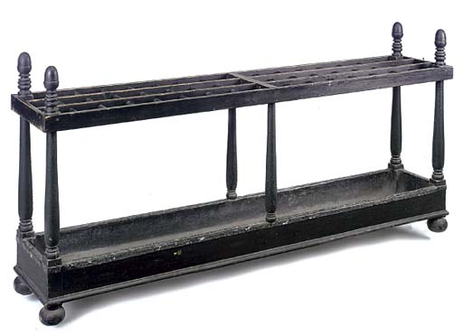 A BLACK JAPANNED STICK STAND