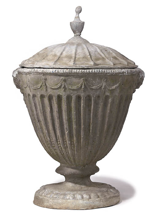 A PAIR OF LEAD GARDEN URNS AND