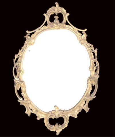 A VICTORIAN OVAL GILTWOOD MIRR