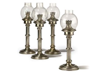 A SET OF FOUR SILVER-PLATED BR