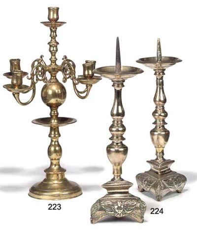 A DUTCH BRASS CANDELABRUM