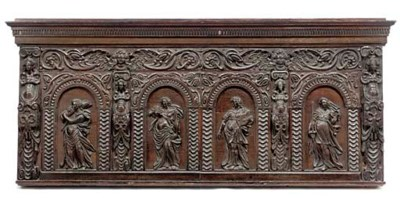 A CARVED OAK OVERMANTEL