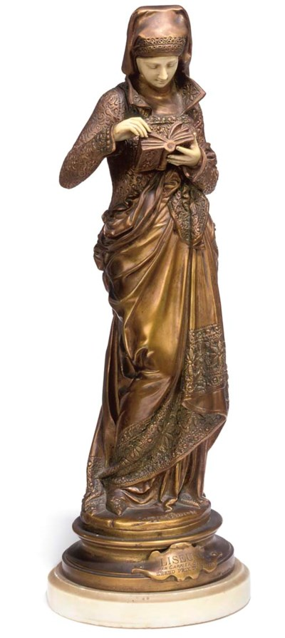 A BRONZE AND CARVED  IVORY FIG