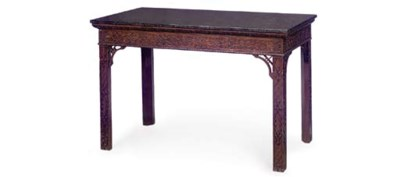 A CARVED MAHOGANY SIDE TABLE