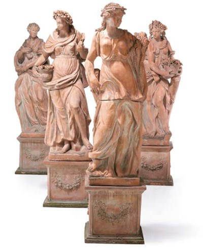 A SET OF FOUR TERRACOTTA FIGUR