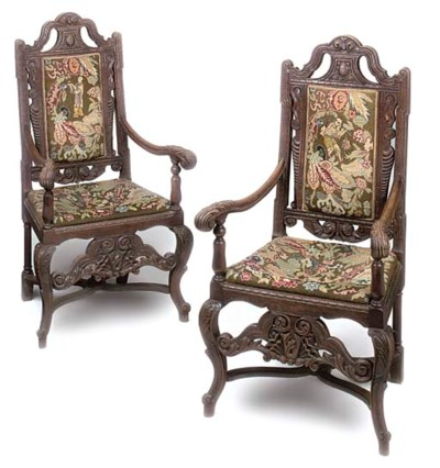 A PAIR OF OAK OPEN ARMCHAIRS