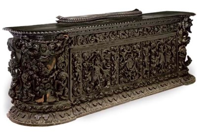 A CARVED STAINED OAK BUFFET
