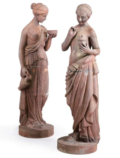 A PAIR OF CAST IRON FIGURES OF