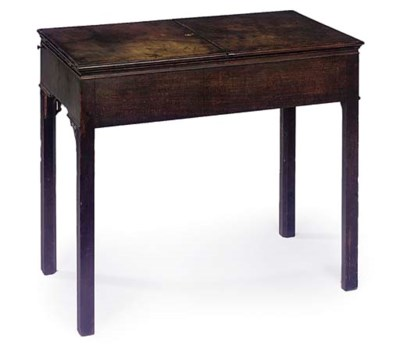 A GEORGE III MAHOGANY ENCLOSED