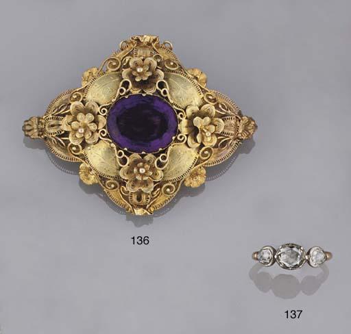 An early 19th century rose-cut diamond three stone ring