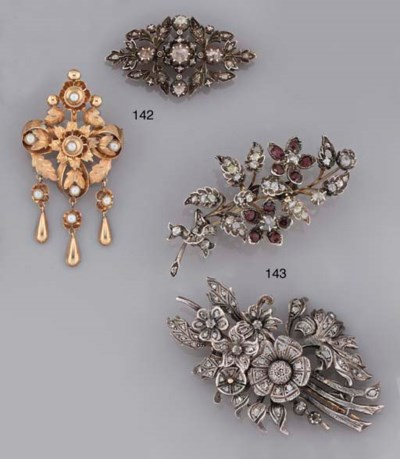 An antique diamond brooch and