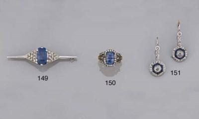 A sapphire and diamond bar bro