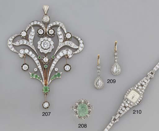 A diamond and emerald pendant