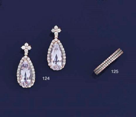 Three diamond eternity rings,