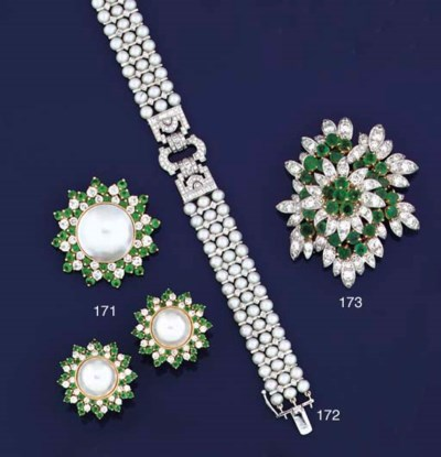 An emerald and diamond clip br