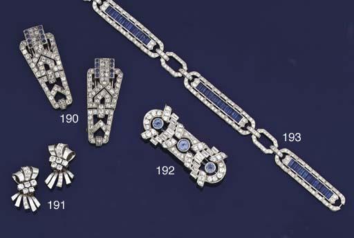 A pair of diamond earclips