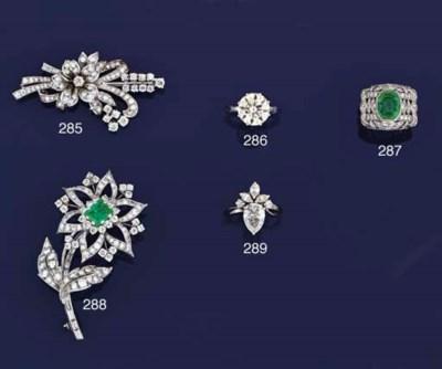 A diamond brooch, retailed by