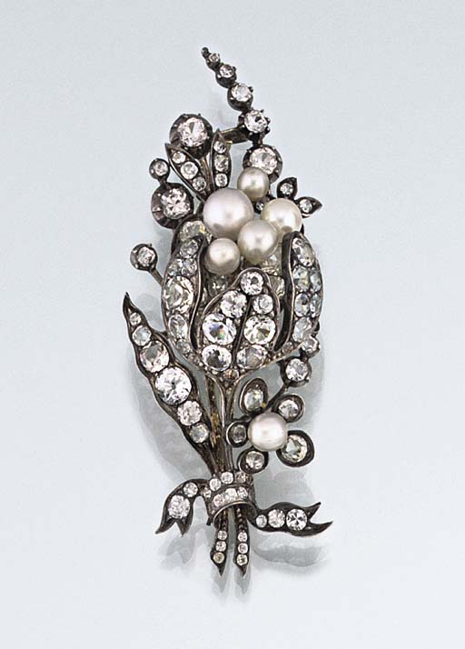A mid 19th century colourless paste and imitation pearl brooch