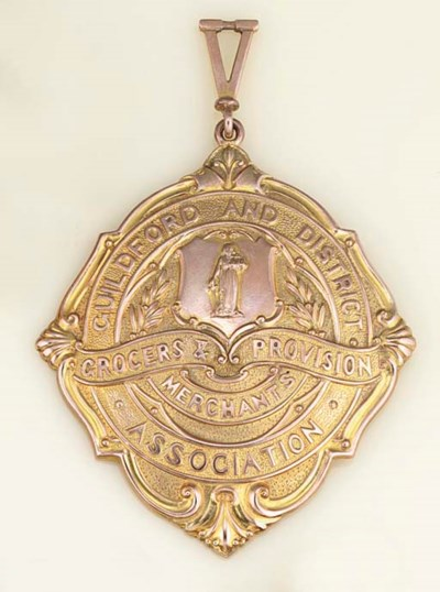 A 9ct. gold badge and chain of