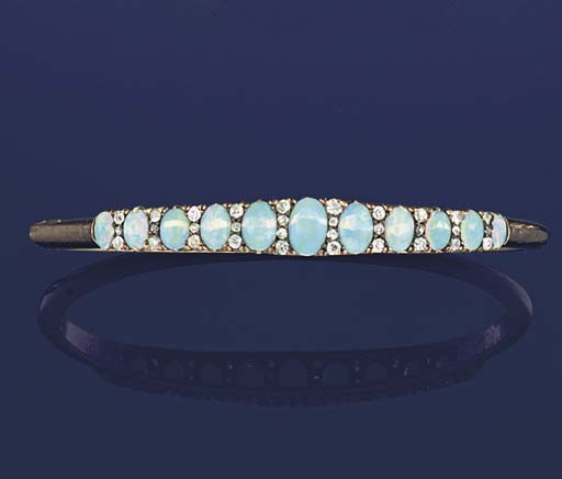 A late 19th  early 20th century opal and diamond bangle