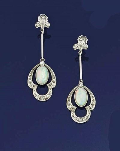 A pair of opal and diamond ear