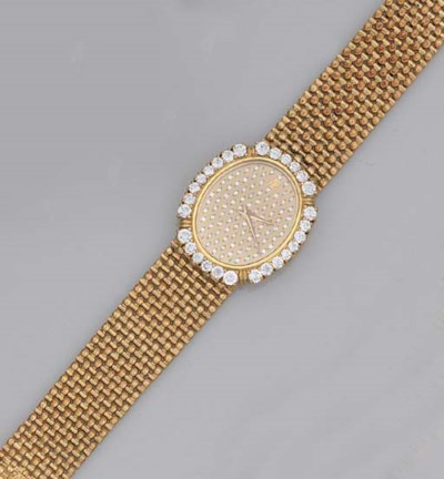 A gold and diamond wristwatch,