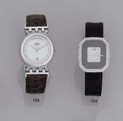 A diamond and onyx watch and c