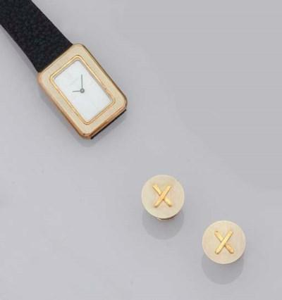 A wristwatch, a pair of cuffli