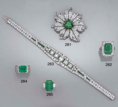 An emerald and diamond flowerh