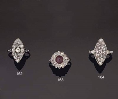 A DIAMOND AND STAR RUBY RING