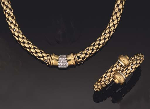 AN 18CT GOLD BRACELET AND A DI