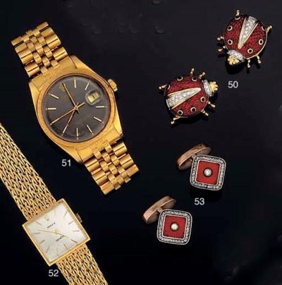 An 18ct. gold calendar wristwa
