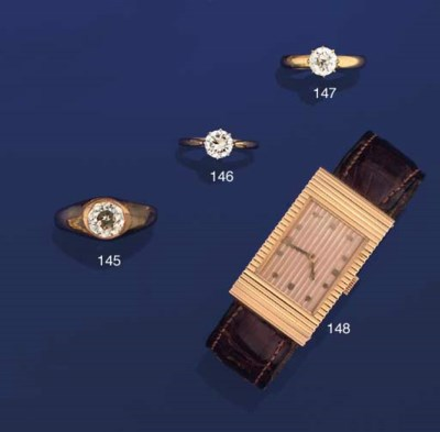 AN 18CT. GOLD WRIST WATCH, BY