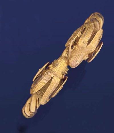 A ruby-set bangle by Lalaounis