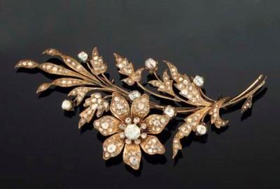 A DIAMOND FLOWER SPRAY BROOCH