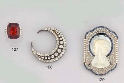 Four diamond set brooches