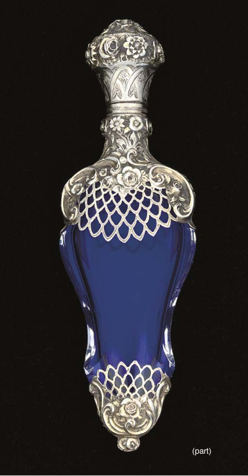 A silver-mounted blue glass sc
