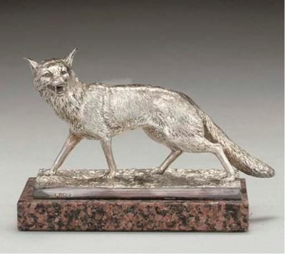 A CAST SILVER MODEL OF A FOX B
