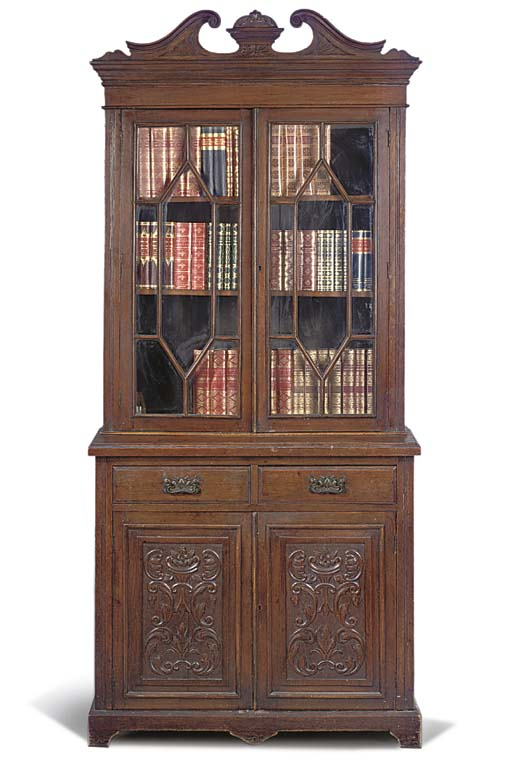 A LATE VICTORIAN OAK BOOKCASE
