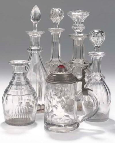 FIVE VARIOUS CUT GLASS DECANTE